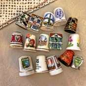 Value of Collectible Thimbles - variety of thimbles, including two that are house shaped