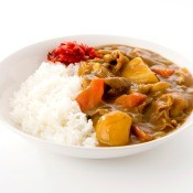 A plate of curry and rice.