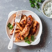 A plate of grilled marinated chicken.