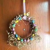 Repurposed Easter Wreath - finished wreath hanging on a door