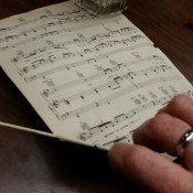 Recycled Mixed Materials Music Theme - rolling up a sheet of music