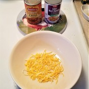 Shredded cheese in a bowl.