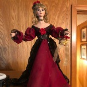 Identifying and Value of a Porcelain Doll - doll wearing a long dark red gown