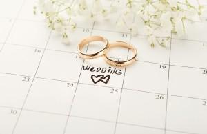 Two wedding rings on a calendar.