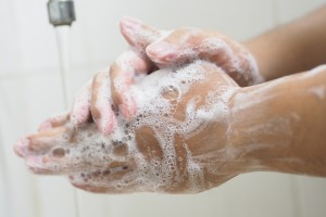 A person thoroughly washing their hands.