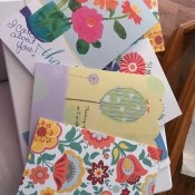 Cheerful greeting cards in a pile.