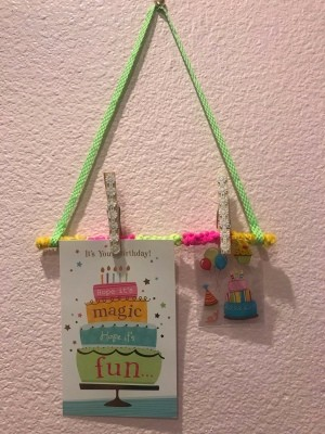 Hanging Memo Holder - hanging on the wall with two items clipped on