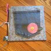 Making a Journal with a Jeans Pocketl - finished bound journal with ribbons tied to spiral binding