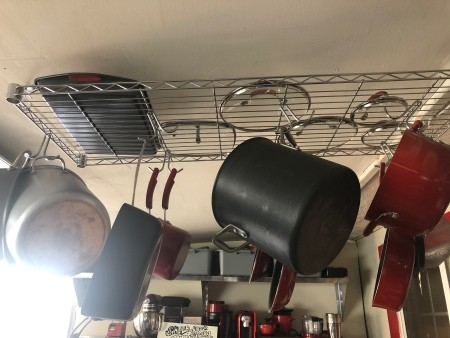 DIY Over the Counter Dish Rack - pots and pans hanging with lids on shelf above