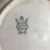 A maker's mark on the back of Saxon china.