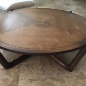 Value of a Bassett Coffee Table - round table divided into quadrants  with the veneer sections creating concentric squares