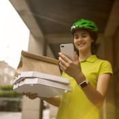 A bike courier delivering a food order.
