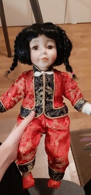 Identifying a Porcelain Doll - doll wearing Asian attire, pants and jacket with frog closure