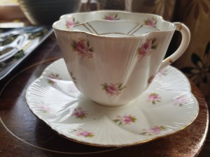 Identifying a Mustache Tea Cup and Saucer  - white cup and saucer with pink rose pattern, it has a mustache guard