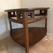 Value of a Mersman Table - medium wood color triangular, corner table with lower shelf