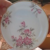Determining the Value of Noritake China - gold trimmed white plate with three clusters of pink flowers