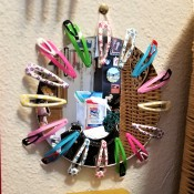 Fun Mirror with Barrettes - mirror hanging on the wall