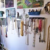 Hanging Necklaces Using Re-purposed Item - wall covered in hanging necklaces and other crafts