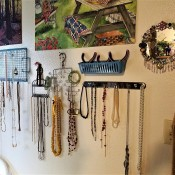 Hanging Necklaces Using Re-purposed Items - necklaces hung and pliers in blue basket