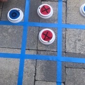 Outdoor Tic Tac Toe Game - tic tac game board made with painter's tape on patio