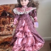 Identifying an Ashley Belle Doll - doll dressed in a layered pinkish purple satin and lace long dress