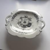 Identifying a Pedestal Serving Dish - black and white floral design dish with decorative handles