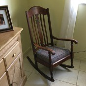 Value of a Murphy Rocking Chair - dark wood old rocking chair in corner of room
