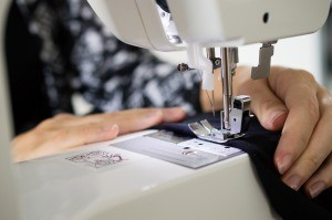 A seam being sewed on a machine.