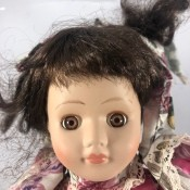 Identifying a Porcelain Doll - well played with doll