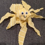 Making a Fabric Octopus - yellow and white striped octopus on grey background