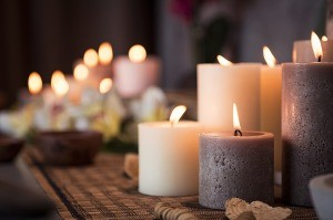 A collection of lit pillar candles.