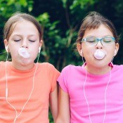 Two girls chewing gum.