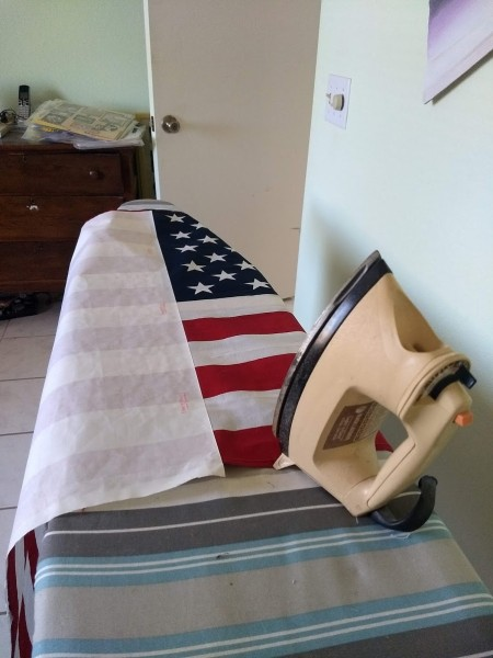 Adhering Heat and Bond to stiffen an American flag.