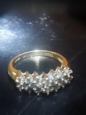 Identifying a Pyramid Cluster Diamond Ring - gold band diamond ring on dark background