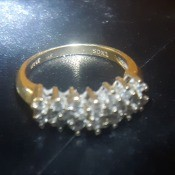Identifying a Pyramid Cluster Diamond Ring - gold band diamond ring on dark background