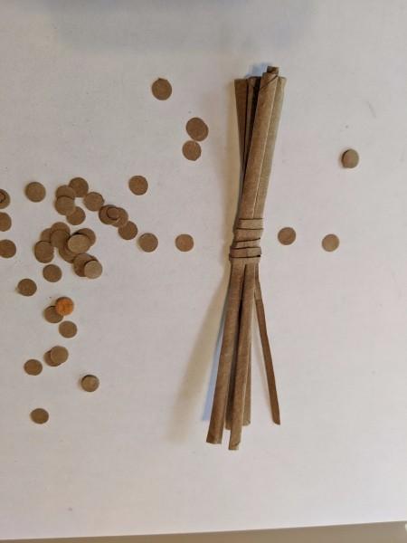 Making Animal Plant Pal Stakes - twisting brown paper to make the stake