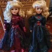 Identifying Porcelain Dolls - two blonde dolls wearing dark blue long dresses