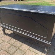 Value of a Lane Cedar Chest - chest with turned legs, painted black