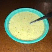 A bowl of creamy blue cheese celery soup.
