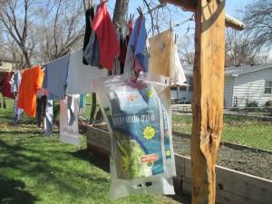 Protecting Clothespin Bag Left on Clothesline - dog food bag slipped over clothespin bag