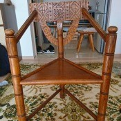 Identifying a Three Legged Turned Chair  - three legged chair with triangle seat, turned legs, and a design carved into the back rest