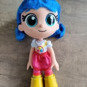 Value of a Prototype Doll - plastic doll with blue hair, very large eyes, and that speaks