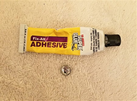 A bottle of Fix-All Adhesive.