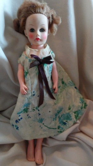 Identifying a Doll - doll with messed up hair wearing a blue and white floral dress, composition unknown