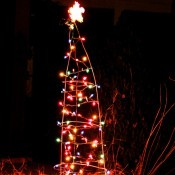 Tomato cage made into a light decorated Christmas Tree