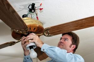 Man Repairing a Ceiling Fan