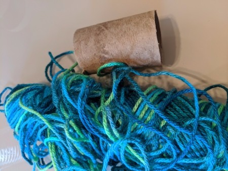 Recycled Paper Tube Bug Toy - paper tube and yarn