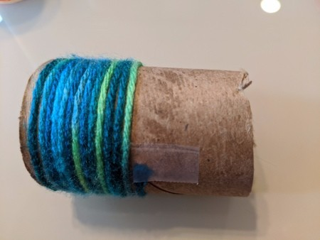 Recycled Paper Tube Bug Toy - wrapping tube with yarn