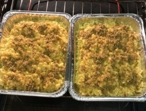 Macaroni and cheese in foil containers.