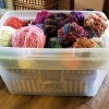 Two Lidless Tubs Become One - one tub inside the other making two storage bins, top filled with yarn balls